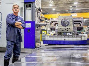 Precision Machining Employee Standing